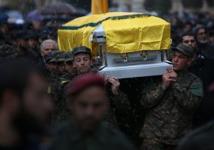 Hezbollah members carry Laqees' casket. Image courtesy of Reuters.